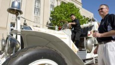 John Vasquez and Raymond Melton admire a 1910 Oklahoma City fire engine parked in front of City Hall for the city's 25th birthday celebration. Photo/Shannon Cornman