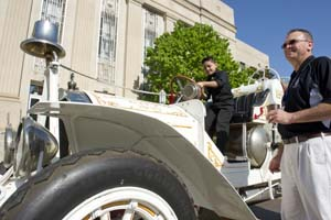 John Vasquez and Raymond Melton admire a 1910 Oklahoma City fire engine parked in front of City Hall for the city's 25th birthday celebration. (Oklahoma Gazette / file)