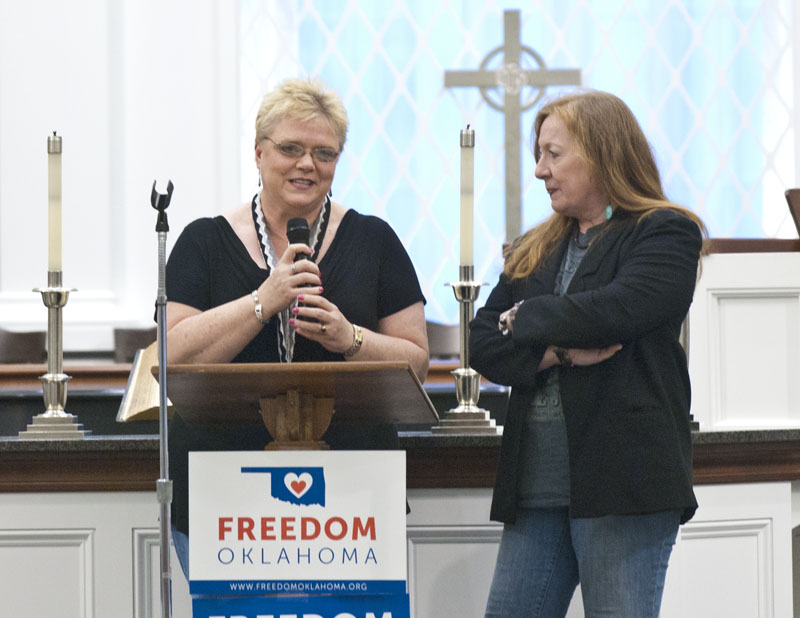 Left, Lynette Erwin and Eseph Waller, one of the gay couples entroducing themselves to the crowd attending the celebration gathering at Mayflower Church on July 18, 2014. (Mark Hancock)