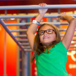 Skylar Lawrence works her way across the horizontal ladder at the Power Play exhibit at Science Museum of Oklahoma. (Shannon Cornman)