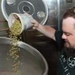 Matt Anthony, founder, pours hops into a brewing vat at Anthem Brewing Company. Oak @ Ore will serve several of Anthem's beers. (Mark Hancock)