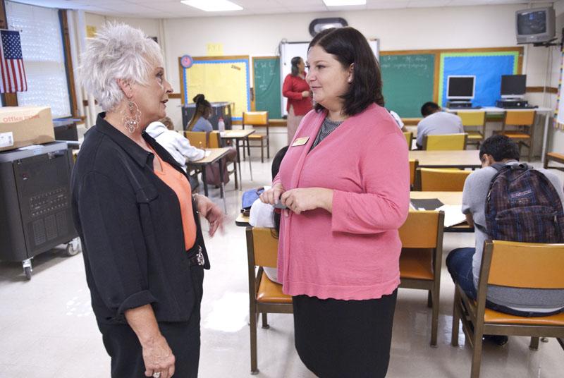 Aurora Lora, right, meets with Emerson Alternative School's principal, Sherry Kishore, in one of the classrooms. (Mark Hancock)