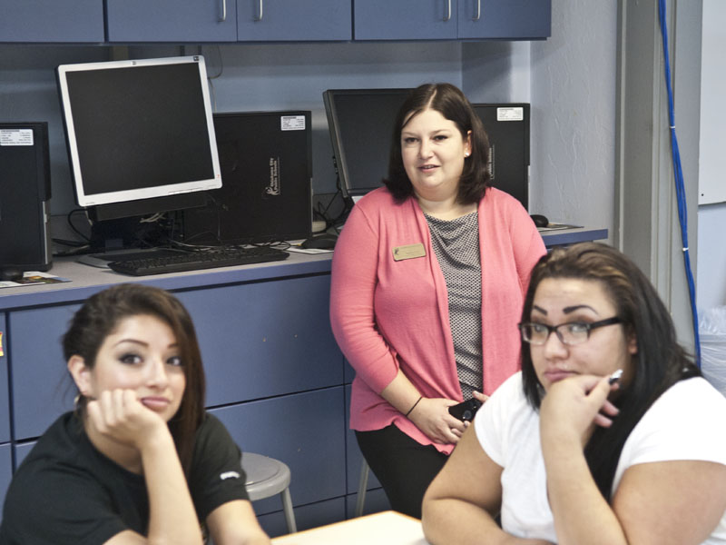 Aurora Lora on a visit to Emerson Alternative School and the Family Consumer Science classroom with students Victoria Ramirez, left, and Esmeralda Perez listening to instruction. (Mark Hancock)