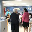 Aurora Lora, right, with Emerson Alternative School's principal, Sherry Kishore, visits Sandra Gooden's Family Consumer Science classroom. (Mark Hancock)
