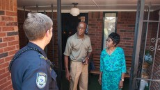 "Midwest City Police Department Community Action Officer Roland ""Rollie"" Branham, speaks with with 86 year old Cora Rolison at her home next  Randolph Grayson a neighbor who lives across the street, recently in MWC.    (Mark Hancock)"