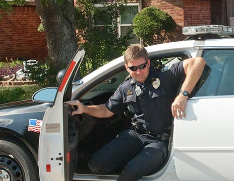 """Community Action Officer Roland """"Rollie"""" Branham arrives in a Midwest City neighborhood to visit with residents on Big Oak Drive.  (Mark Hancock)"""