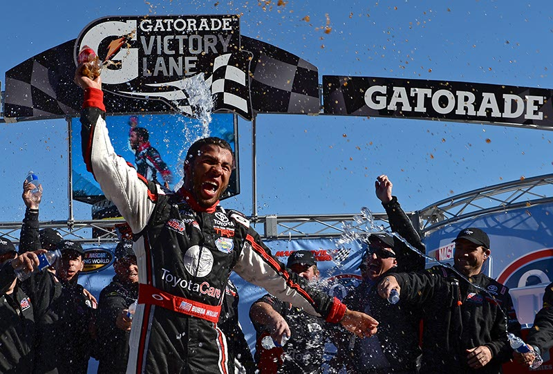 Darrell Wallace Jr. celebrates in victory lane after winning the NASCAR Camping World Truck Series Kroger 200 last October.  (Photo by Robert Laberge/NASCAR)