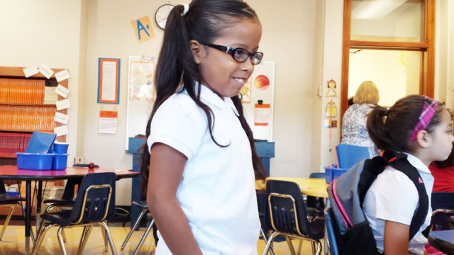 A Mark Twain Elementary student walked into class on the first day of school. (Ben Felder)
