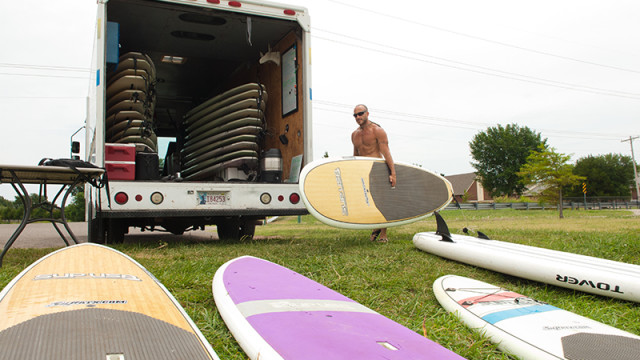 Flat Tide Mobile Surf rentals', Eric Pappas, with his truck and rental boards parked at the North Canadian River section conecting Lake Overholser with Stinchcomb Wildlife Refuse. (Mark Hancock)