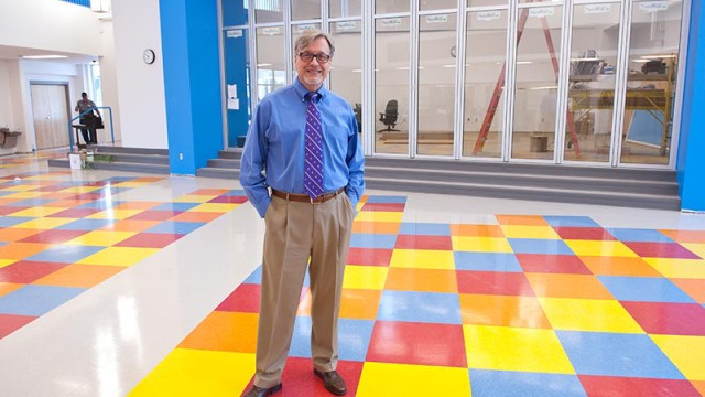 Joe Pierce, Head of School, inside a commons area at the new John Rex School.  (Mark Hancock)