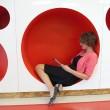 Karin Rowe, a Kindergarten teacher, demonstrates the circular reading spaces, at the new John Rex School.  (Mark Hancock)