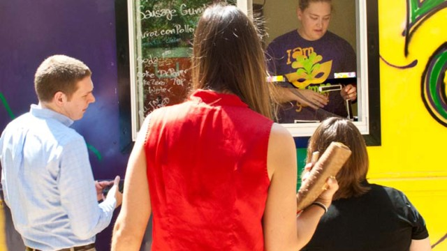 Rachel  Fontanez works the window at the La Gumbo Ya Ya food truck, shown at corporate lunch event.  (Mark Hancock)