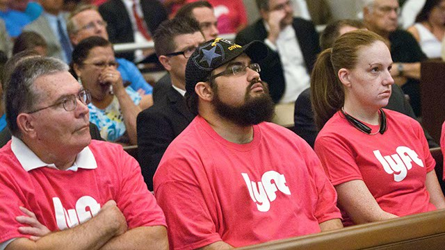 Lyft drivers including James Keenean, center, pay attention during OKC Council meeting proceedings on Aug. 26, 2914. (Mark Hancock)
