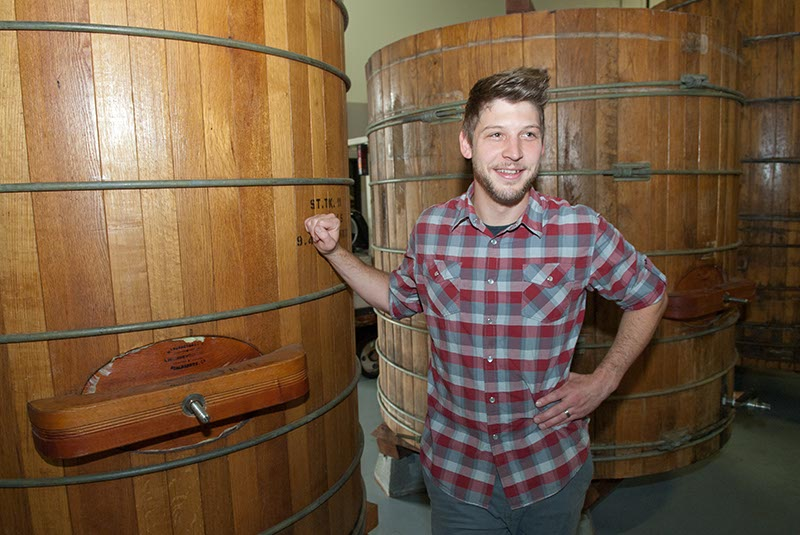 Oak & Ore's Micah Andrews with wooden brewing vats at Anthem Brewing Company, who's beer will be served in his new venue in the Plaza District.  (Mark Hancock)