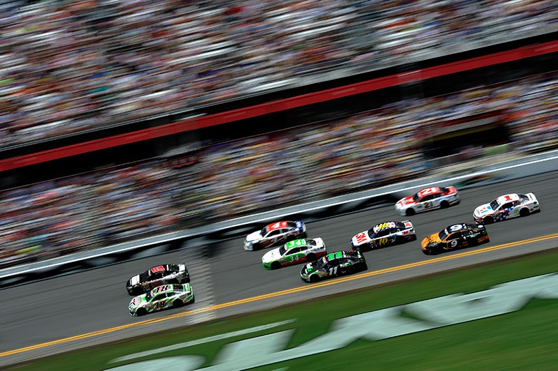 Kyle Busch, driver of the no. 18 Interstate Batteries Toyota, and Dale Earnhardt Jr., driver of the no. 88 National Guard Chevrolet, lead a group of cars at Daytona International Speedway in July.  (Jared C. Tilton/NASCAR via Getty Images)
