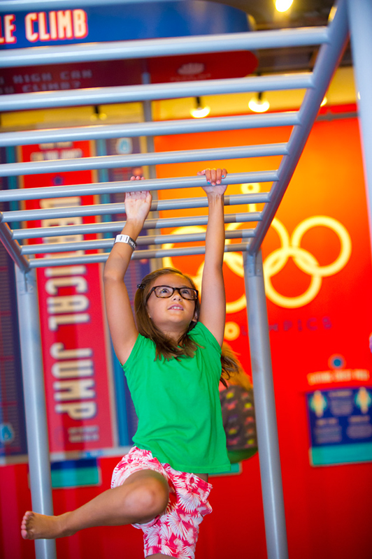 Skylar Lawrence works her way across the horizontal ladder at the fairly new Power Play exhibit at Science Museum of Oklahoma. (Shannon Cornman)