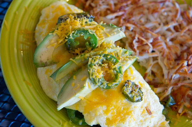 A three-egg omelet surrounded with jalapeños, cheddar and  avocado. (Shannon Cornman)