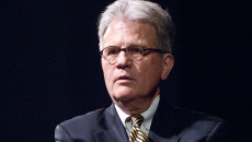 Tom Coburn speaks Monday evening at a town hall meeting. (Mark Hancock)