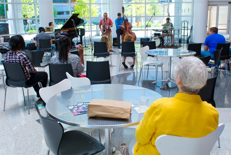 Library patrons watch the Kanaga Piano Jazz Quartet's Noon Tunes performance. (Shannon Cornman)