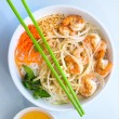 Stir fried shrimp with onions and lemon grass in vermacelli bowl. (Shannon Cornman)