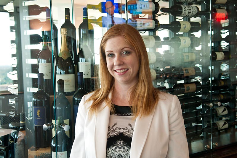 The George's female sommelier Mindy Magers with its extensive wine collection. (Mark Hancock)