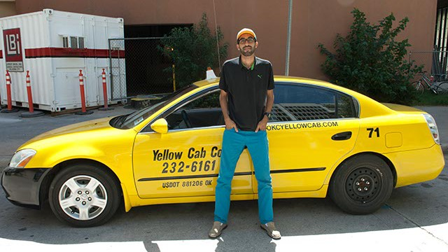 Yellow Cab driver, Abdul Nachi, poses in his waiting spot in downtown OKC. (Mark Hancock)