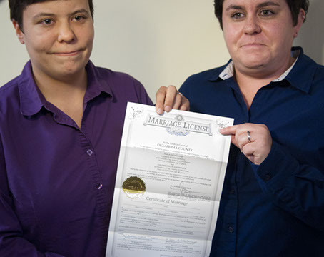 First gay couple to get their marriage license at the Ok. County Courthouse, Sara Yarbrough, left,  and Lauren Tidwell, display their Marriage License at the Coutny Courthouse Oct. 6, 2014. (Mark Hancock)