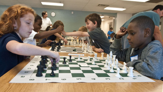Students playing chess as part of the new chess program at Wilson Elementary. (Mark Hancock)
