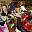 Gloria Carreon holds up a purple pointed toe boot at El Rancho. (Shannon Cornman