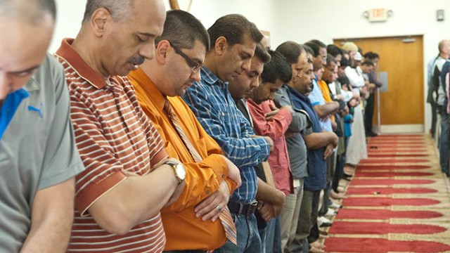 Adam Soltani, CAIR executive director, 3rd from left, prays with members and guests of the Islamic Society of Geater Oklahoma City attending a 2:00 pm service. (Mark Hancock)