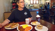 Chef and owner Patrick Nault sits behind an order including the Oh, My Reuben! sandwich, traditional eggs and bacon, biscuits and a blueberry muffin at Shartel Cafe. (Mark Hancock)
