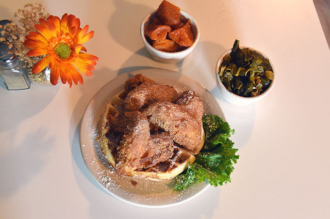 Mama E's wings and waffles special with candied yams and collard greens.  (Mark Hancock)