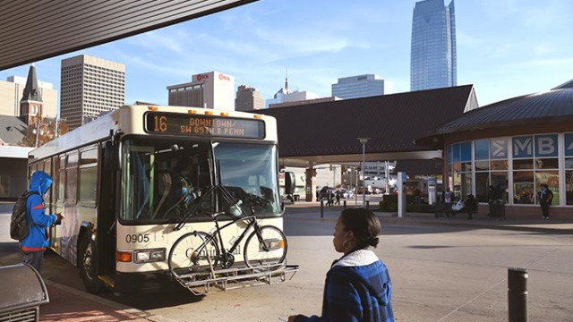 Riders walk up to a bus in the Downtown OKC Transit Station. (Mark Hancock)