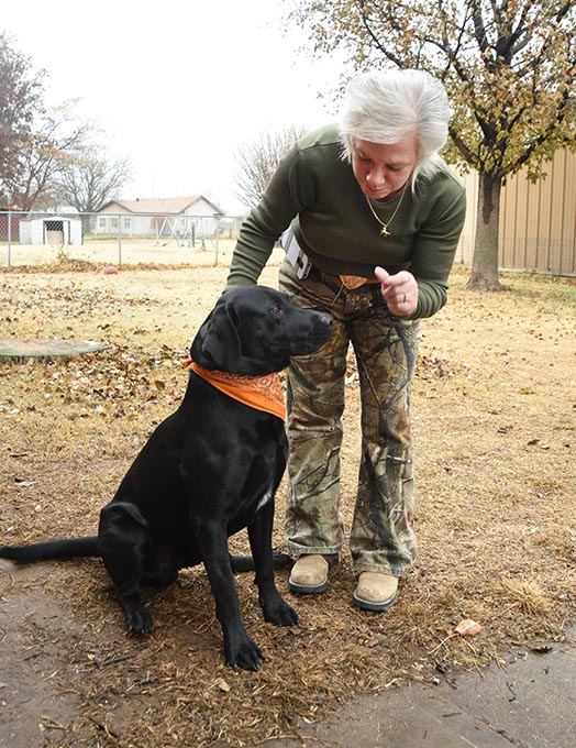 Marie Ramsey Hirst with her hunting dog, Colt 45 Paws.  mh