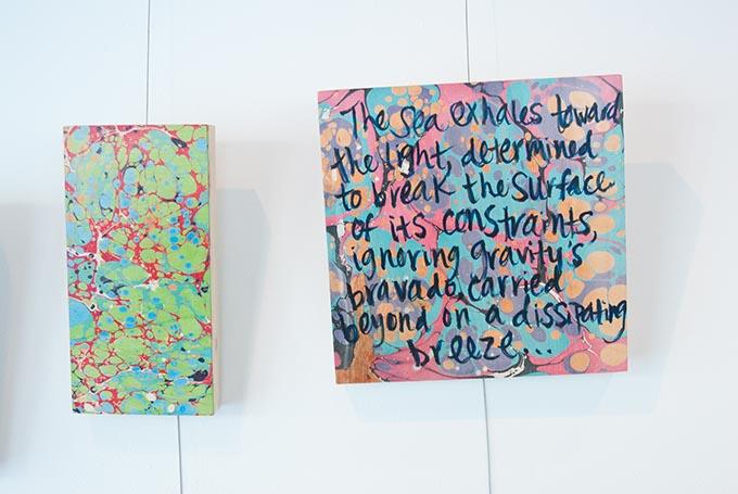 Kerri Shadid, Skirvin Hilton's artist-in-residence, creates poems on paintings, shown here on the wall of her Skirvin studio. (Mark Hancock)