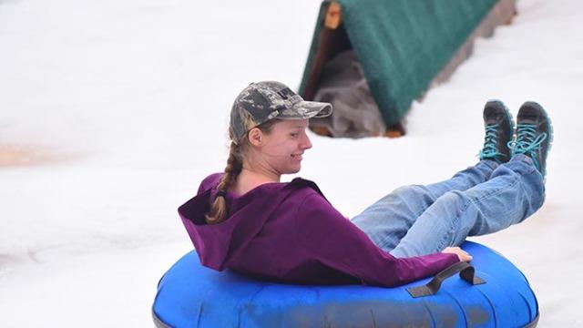 People enjoying snow tubing at the Bricktown Ballpark, 12-13-14.  mh