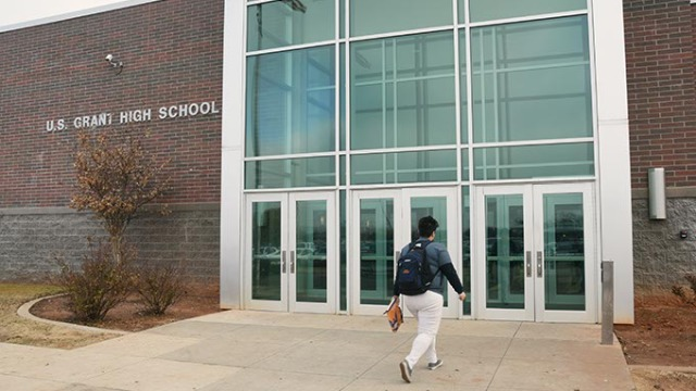 A student heads for the entrance at U.S. Grant High School in OKC. (Mark Hancock)