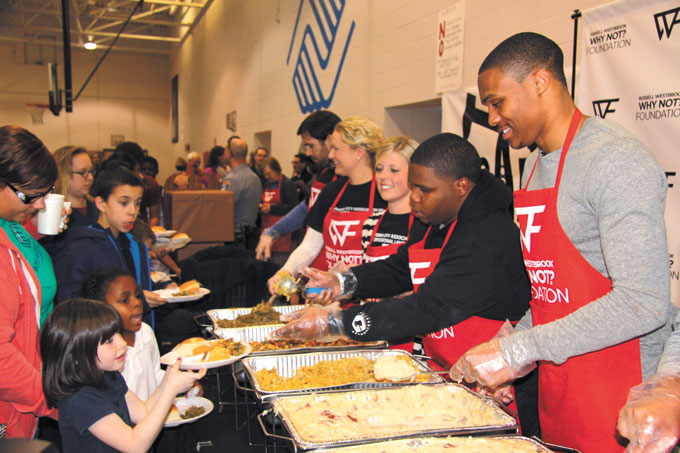 OKC Thunder star Russell Westbrook took time to serve food and sign autographs at a recent event for Boys & Girls Clubs of Oklahoma. (Provided)