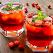 Use all those cranberries to liven spirits in this cranberry mojito.