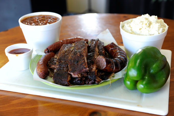 Value Pack #2 with a slab of ribs, Polish hot links, baked beans and potato salad at Bog Boy's Bar-B-Que in Oklahoma City.  (Garett Fisbeck)
