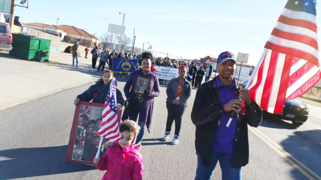 A few hundred participated in a march to honor the legacy of Martin Luther King, Jr. along 23rd Street on Jan. 19, 2015. (Ben Felder)