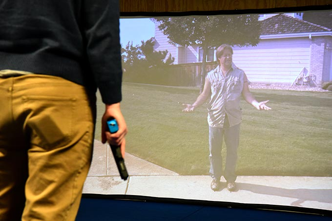 Oklahoma Gazette reporter Ben Felder tries his still with a simulation program. (Mark Hancock)