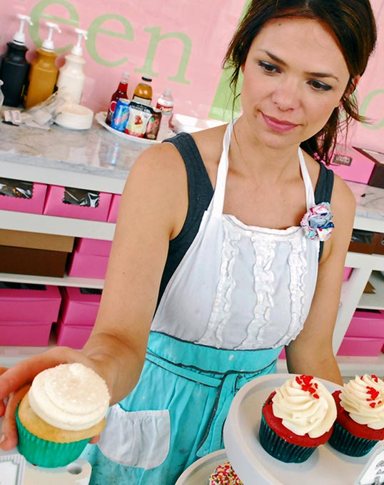Tiffany Magness, owner of Green Goodies, adjusts her cupcakes at Classen Curve.  (Mark Hancock)
