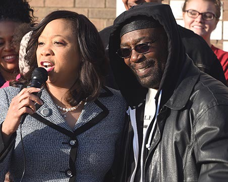 """Senator Anastasia Pittman next to former NAACP leader Roosevelt Melton, addressing a crowd gathered at the Freedom Center, 2609 N. Martin Luther King Avenue, Monday morning, marking MLK Day before she and other leaders embarked on a """"Silent March"""" to the State Capitol.  (Mark Hancock)"""