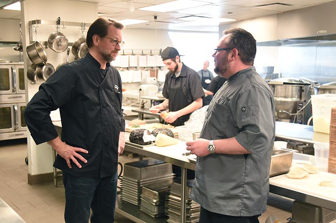 Vast Restaurant Director Kirt Fleischfresser, left, discusses the evening dinner with executive chef Patrick Williams. (Mark Hancock)