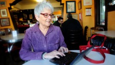 Claudia Swisher on her computer at Red Cup in Oklahoma City, Thursday, Jan. 15, 2015.  (Garett Fisbeck)