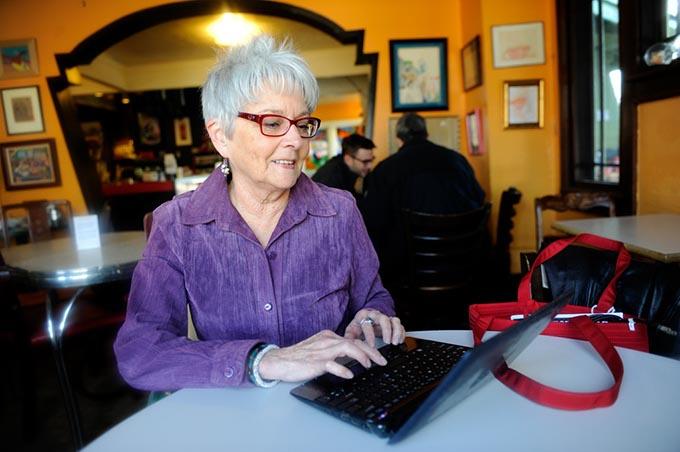 Claudia Swisher works on her computer at The Red Cup in Oklahoma City.  (Mark Hancock)