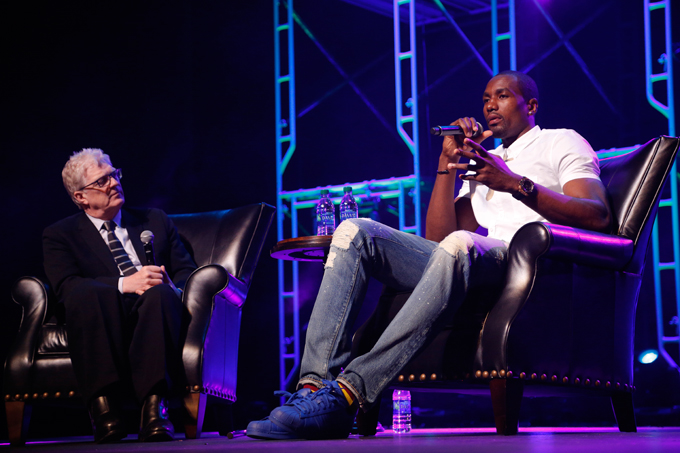 Serge Ibaka speaks with Sir Ken Robinson during the Creativity World Forum at the Civic Center in Oklahoma City, Tuesday, March 31, 2015.  (Photo by Garett Fisbeck)