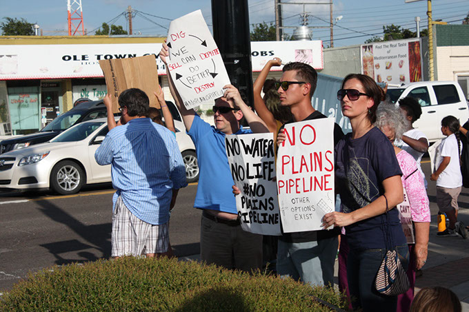 Members of the group Stop the Plains All American Pipeline protest a proposed pipeline to transport crude oil from Cushing to Longview, Texas, in Norman on Sept. 7. (Laura Eastes)